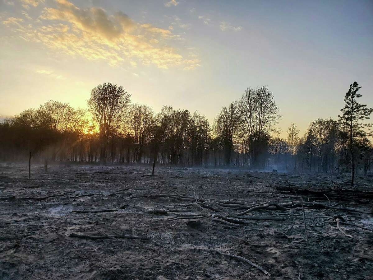 Smoke rises from the ground as the sun sets on the Colfax Fire in Wexford County.The fire, which was reported shortly after 4:30 p.m. Tuesday, May 25, burnedabout 378 acres of both private and state forest land. (Courtesy/Michigan DNR)