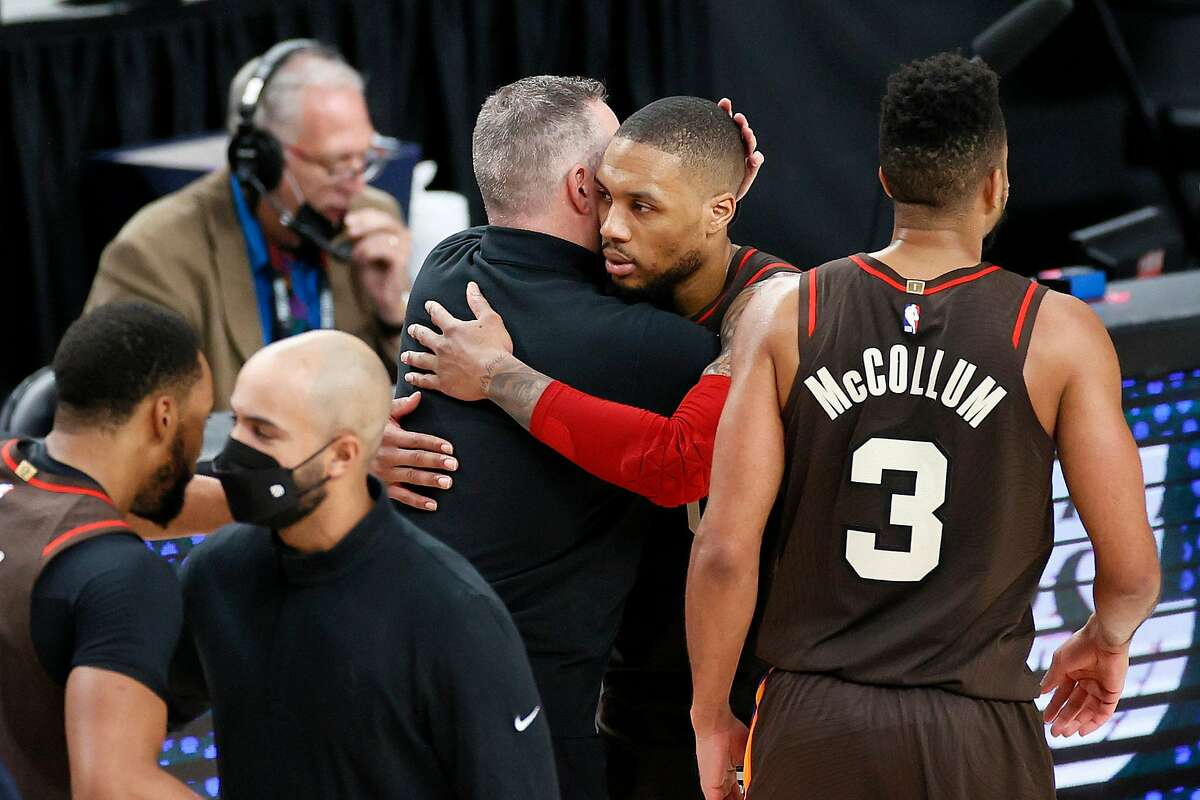 PORTLAND, OREGON - JUNE 03: Head coach Michael Malone of the Denver Nuggets and Damian Lillard #0 of the Portland Trail Blazers greet one another after the Denver Nuggets beat the Portland Trail Blazers 126-115 during Round 1, Game 6 of the 2021 NBA Playoffs at Moda Center on June 03, 2021 in Portland, Oregon. NOTE TO USER: User expressly acknowledges and agrees that, by downloading and or using this photograph, User is consenting to the terms and conditions of the Getty Images License Agreement. (Photo by Steph Chambers/Getty Images)