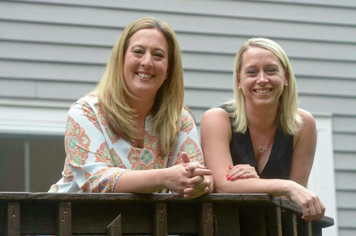 Jenn Larkin, left, and Janet Kuzma, of Newtown, both are parents of students in Newtown schools. They are advocating mask choice for schools this fall. Thursday, June 3, 2021, in Newtown, Conn.