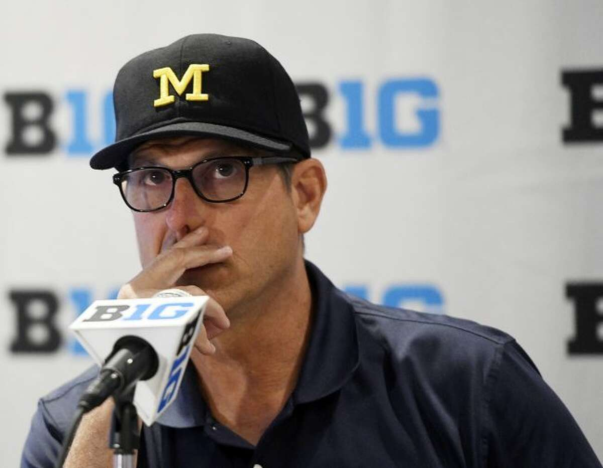 In this July 23, 2018 file photo, Michigan head coach Jim Harbaugh speaks at the Big Ten Conference NCAA college football Media Days in Chicago. Harbaugh was at the Michigan Showcase at Ferris State on Thursday.