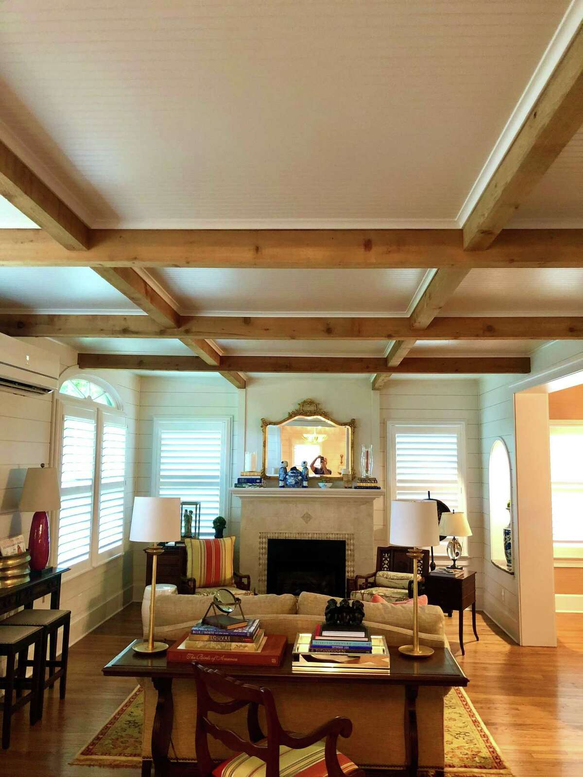 The eye-catching coffered ceilings in Helen and Mitch Seal's Alta Vista home were created with decorative cedar beams and bead board paneling of the kind typically used as wainscoting.