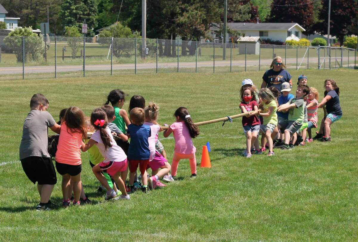 Jefferson Elementary students compete in tug of war at Chippewa Field on Thursday. (Kyle Kotecki/News Advocate)