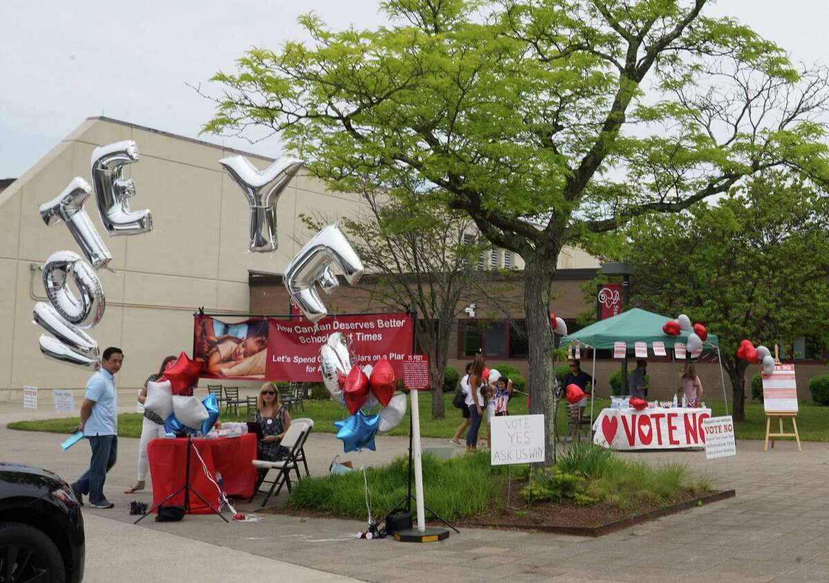 Proponents of voting 'yes' and those voting 'no' both had tables outside New Canaan High School where residents and property owners voted on the school budget referendum Wednesday, June 2.