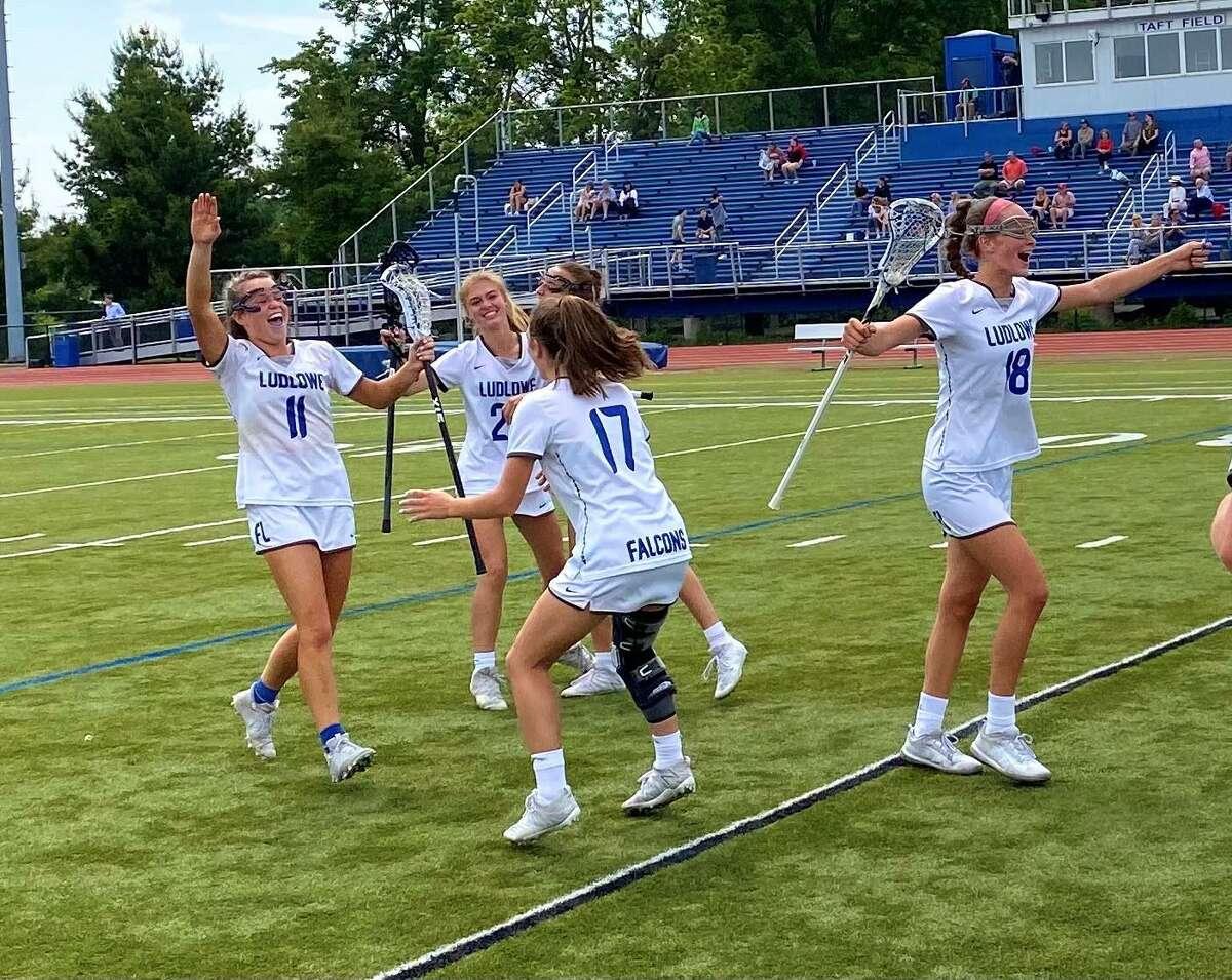 The Ludlowe High School girls lacrosse team celebrates its 10-5 win over Greenwich High School in the CIAC Class L quarterfinals on Friday, June 4, 2021 at Taft Field in Fairfield, Conn.