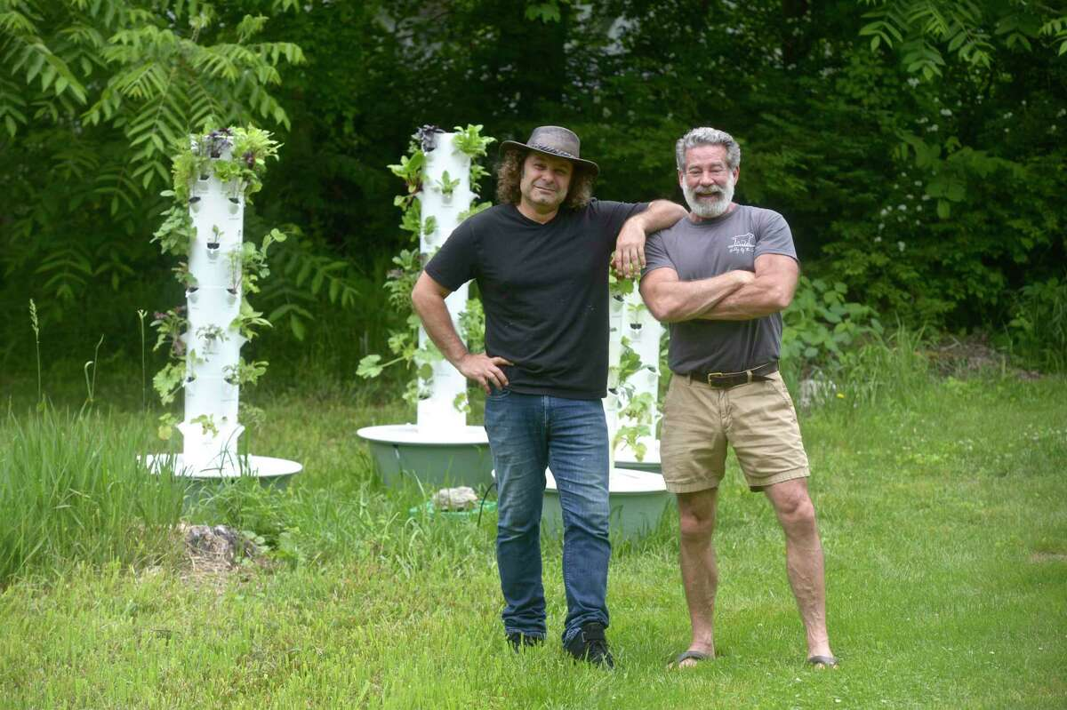 Alessandro Piovezahn, owner of Hunt Hill Farm and The Silo, left, and Hamilton Brower, who is starting a new nonprofit initiative that he's calling Nourish New Milford that utilizes aeroponic towers to cultivate fresh produce. Friday morning, June 4, 2021, in New Milford, Conn.