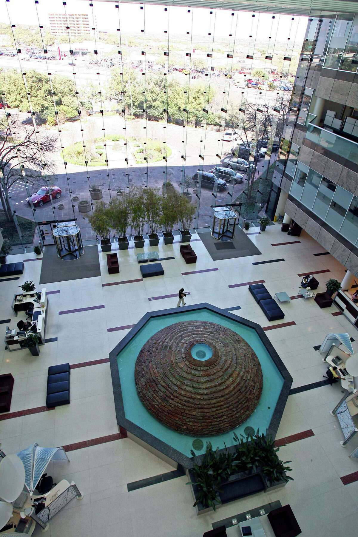 USAA Federal Savings Bank has settled a lawsuit filed by a Virginia woman who alleged the bank attempted to collect a credit card debt by calling her at least 130 times over a two-month span last year. Pictured is the bank's lobby in San Antonio.