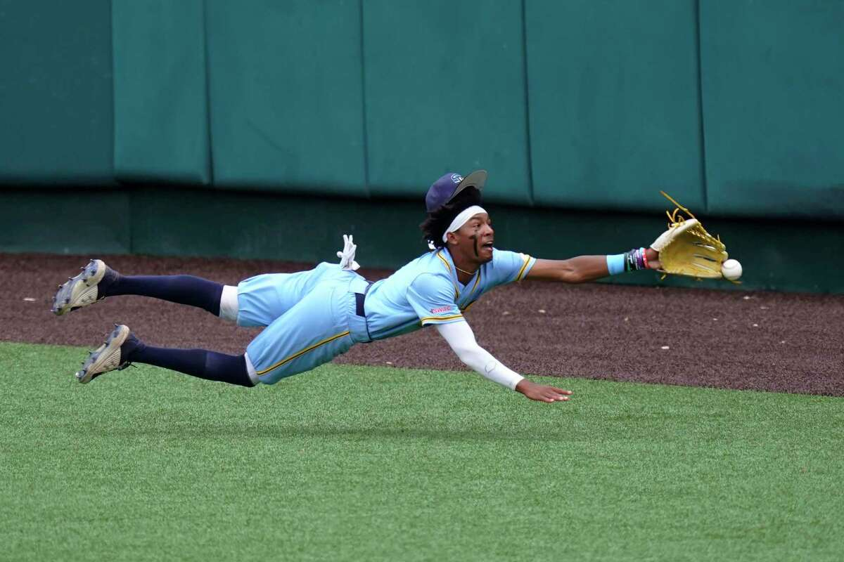 Southern centerfielder Isaiah Adams dives for a hit by Texas' Mitchell Daly in the second inning of an NCAA regional tournament college baseball game on Friday. Three runs scored on the play as Texas won 11-0.