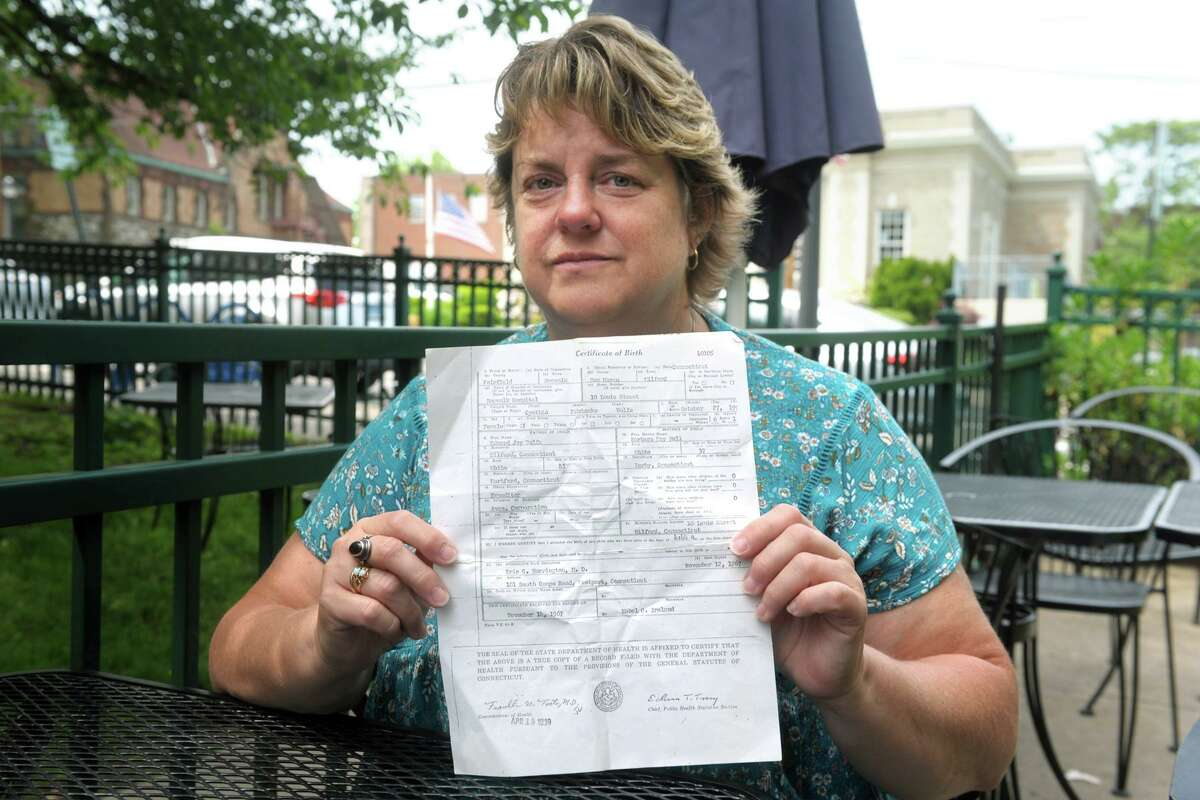 Cindy Boynton holds a copy of her birth certificate in Milford on Wednesday.