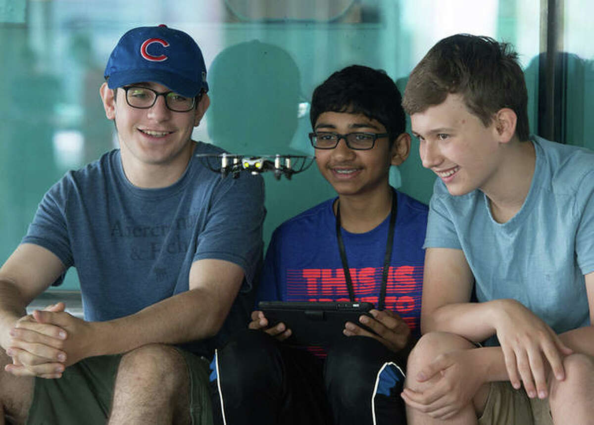 Left to right, students Phil Gokhman and Ishan Shah, both of Chicago, and Orion Gregory, of Glen Carbon, watch a drone flight during SIUE Summer Engineering Camp in June 2018.