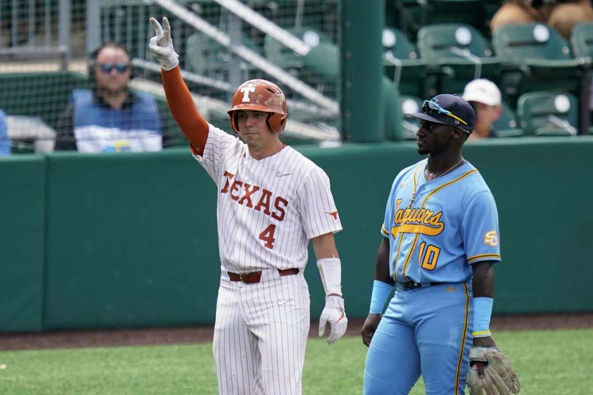 Texas catcher Silas Ardoin (4) celebrates next to Southern third baseman Zavier Moore (10) after his hit in the seventh inning of an NCAA regional tournament college baseball game,, Friday, June 4, 2021, in Austin, Texas. (AP Photo/Eric Gay)