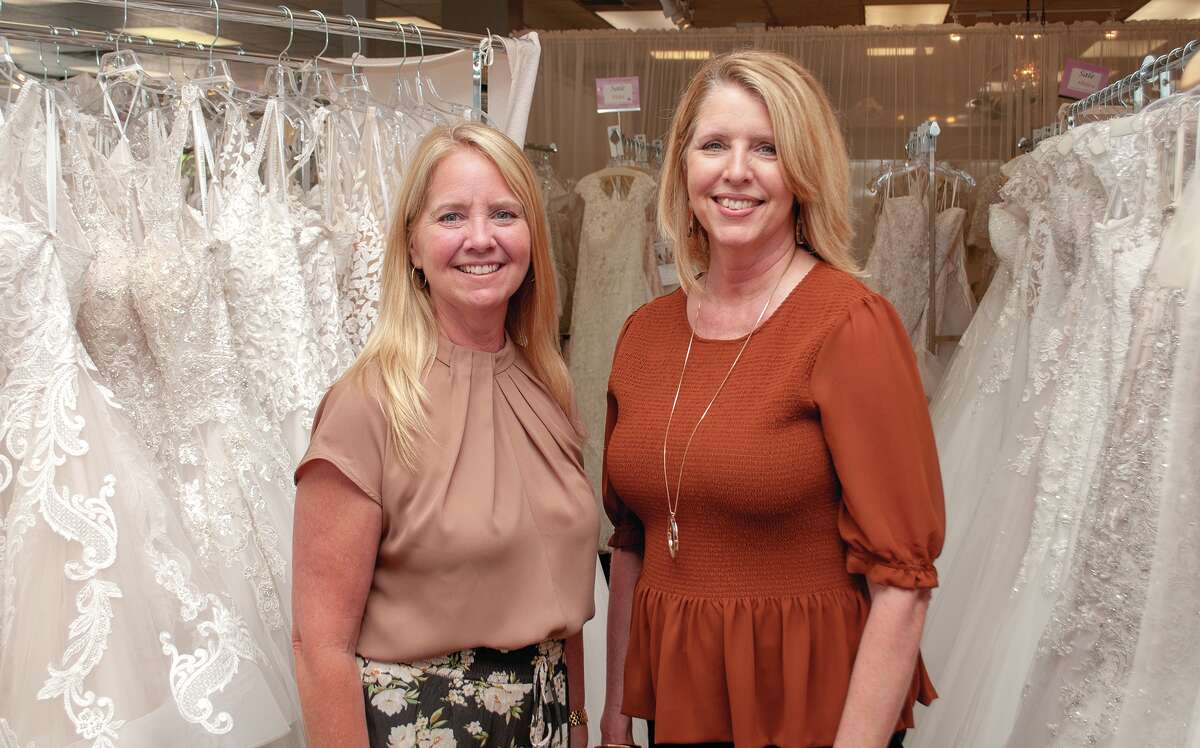 Terryl Boulanger (left) and Becky Baumgart, co-owners of Girls in White Satin, have been busy since the state has been opening up and brides are now able to plan their wedding day and order their dresses, bridesmaid dresses and tuxedos.