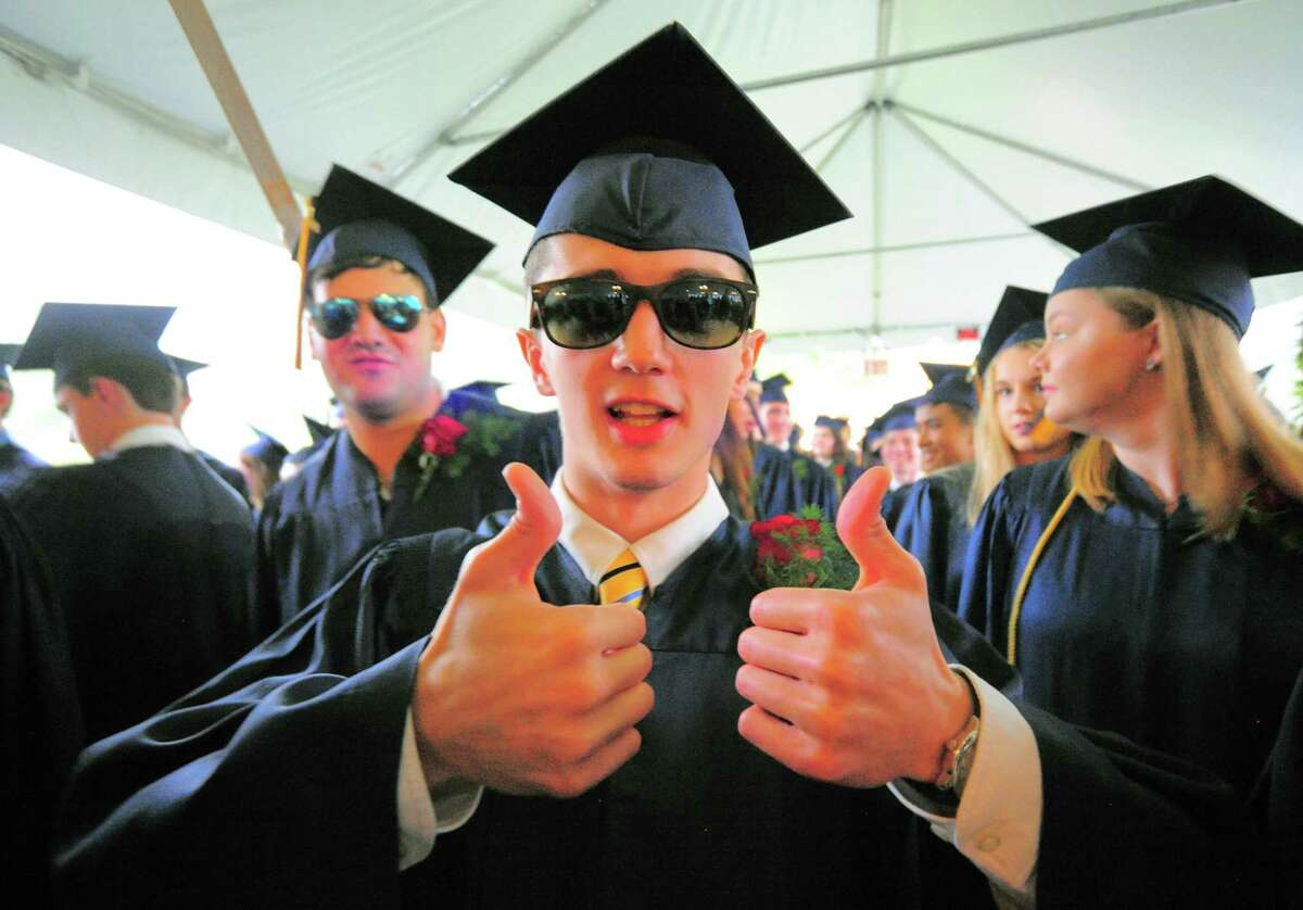 Graduate Mark Garavel gives the thumbs up as he waits for the start of King School's Commencement Exercises in Stamford, Conn., on Friday June 4, 2021.
