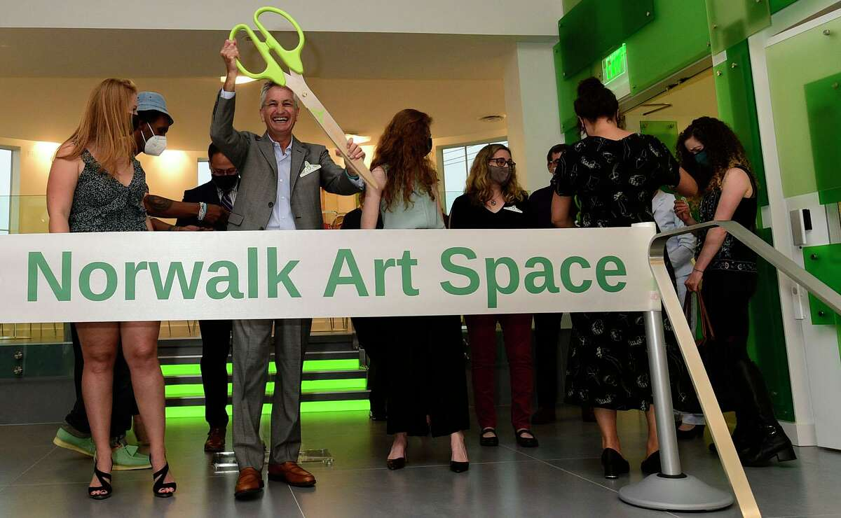 Husband of the late founder, Alexandra Davern Korry, Robin Panovka, leads the ribbon cutting during the grand opening reception for the Norwalk Art Space Friday, June 4, 2021, in Norwalk, Conn.