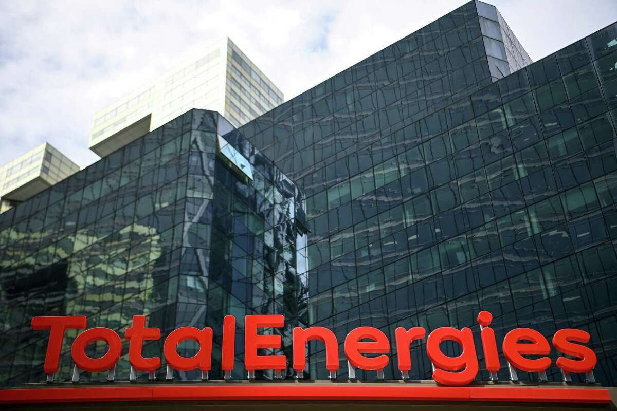 This photograph taken on May 28, 2021 shows the new TotalEnergies logo during its unveiling ceremony, at La Defense on the outskirts of Paris. - Total shareholders voted on the strategy of the oil and gas giant, which renamed itself TotalEnergies to mark its diversification, while some investors are urging it to act more quickly. (Photo by Christophe ARCHAMBAULT / AFP) (Photo by CHRISTOPHE ARCHAMBAULT/AFP via Getty Images)
