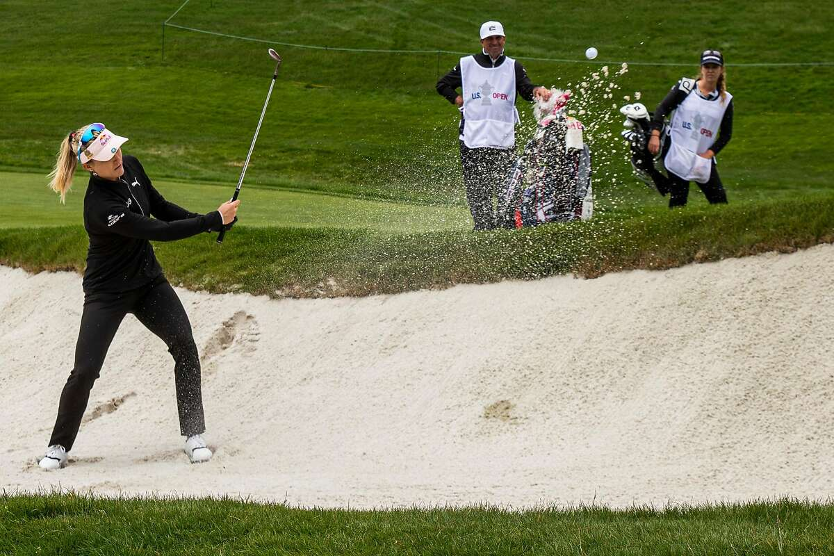 Lexi Thompson hits out of the bunker on the third hole of the Lake Course during the second round. Thompson shot a 71.