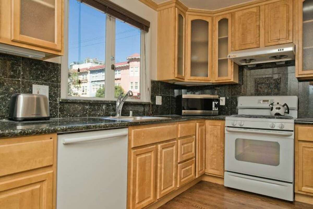 The kitchen has a dishwasher, a garbage disposal and ample counter space and storage.