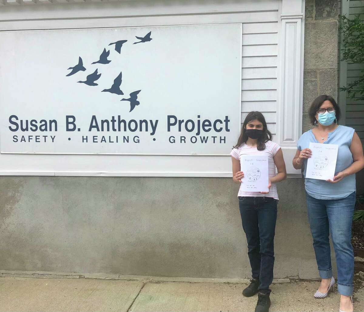 Cianna Ferraro, 13, an eighth-grader at Northwest Regional No. 7, created and donated more than 80 coloring books with uplifting messages and activities to the Susan B. Anthony Project June 4. She is pictured with Gina Devaux from Susan B. Anthony.