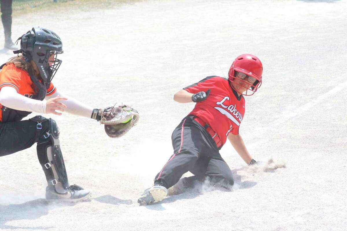 Dafne Yanez slides into home plate during Bear Lake's softball districts loss to Mesick on June 4. (Robert Myers/News Advocate)