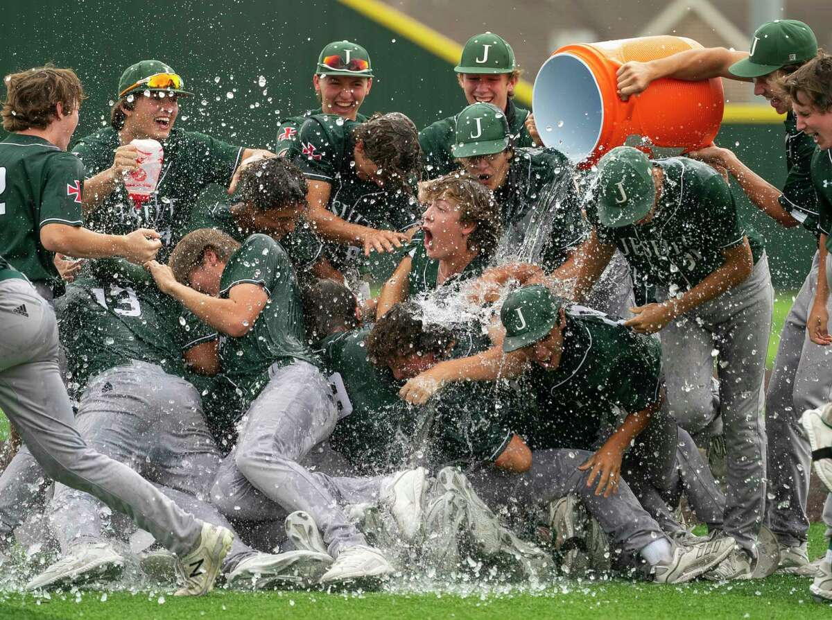 The Strake Jesuit baseball team celebrates after winning their game against Jersey Village to advance to the 6A state tournament, Friday, June 4, 2021, at Cypress Falls High School in Houston.