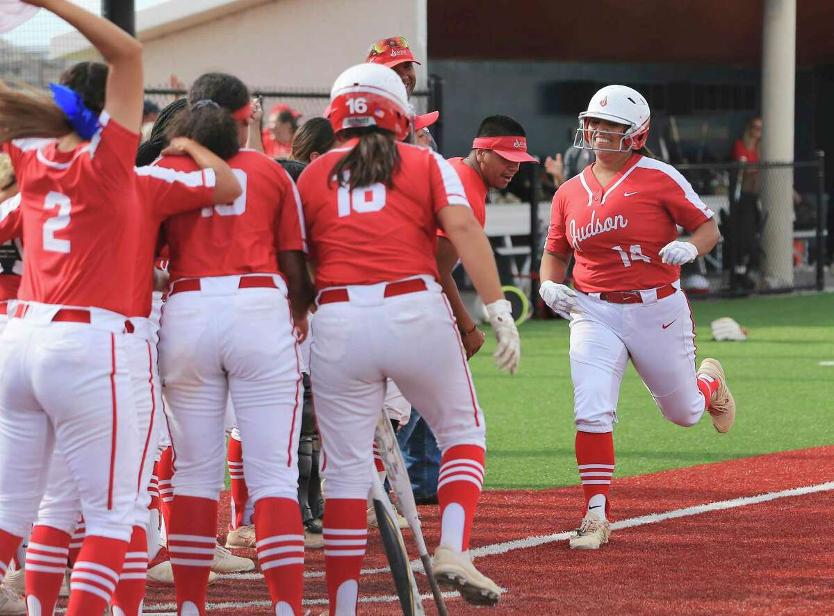 Lauryn Ramos (14) runs home after hitting a two-run homer, her ninth of the season and Judson's 60th of the year.