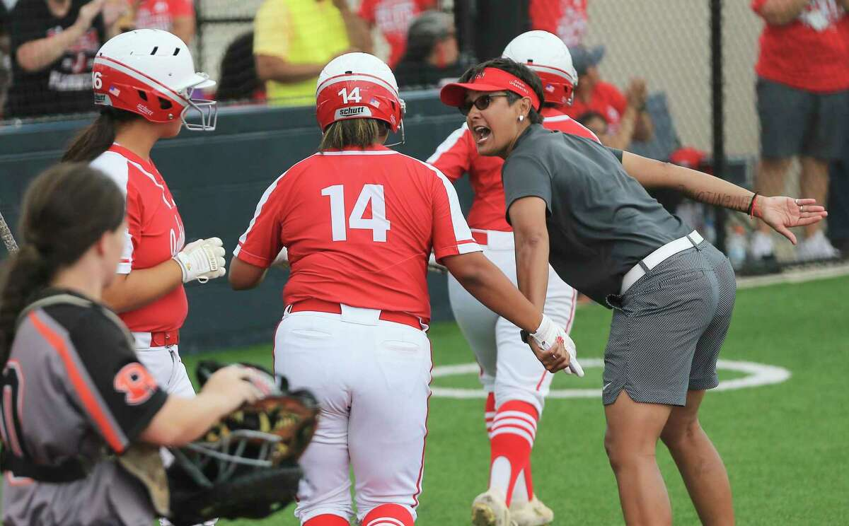 Judson softball coach Theresa Urbanovsky (right) encourages Lauryn Ramos (14) after she hit a sacrifice fly that brought in a run in the first inning against Rockwall in the Class 6A state softball semifinal game in Leander, Texas on Friday, June 4, 2021. The Rockets advanced to the state finals with a victory over Rockwall, 6-2.