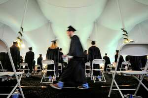 Graduates file to their seats for the start of King School's Commencement Exercises in Stamford, Conn., on Friday June 4, 2021.