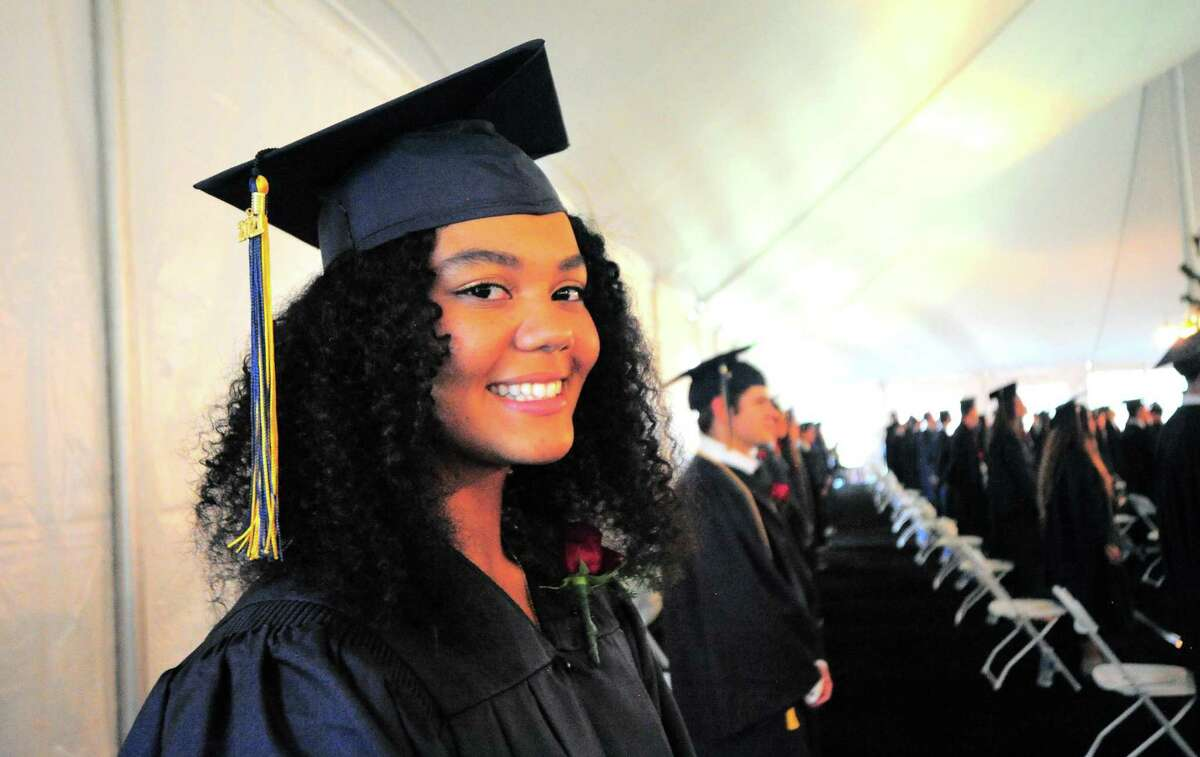 Graduate Milei Wyatt smiles for the camera at the start of King School's Commencement Exercises in Stamford, Conn., on Friday June 4, 2021.