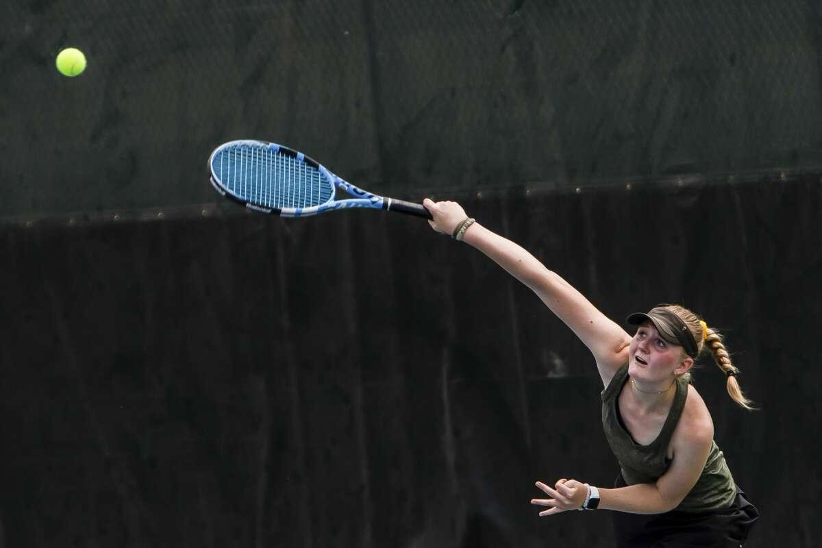 Dow High's Savannah Matuszewski serves the ball during a May 20, 2021 regional match at the Greater Midland Tennis Center.