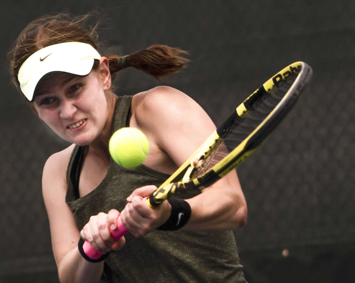 Dow High's Zoe Angell hits a backhand during a May 20, 2021 regional match at the Greater Midland Tennis Center.