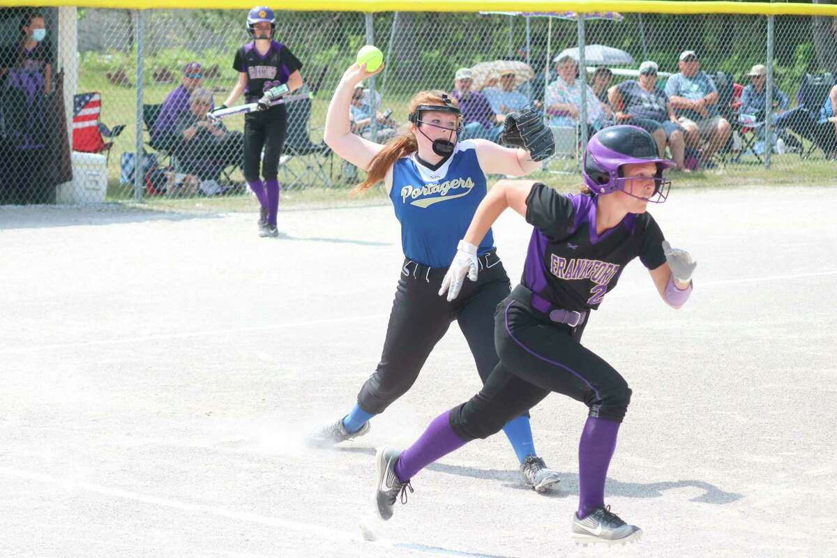 Cheryl Showalter guns to first on a bunt attempt by Frankfort's Madi Clouse. (Robert Myers/News Advocate)