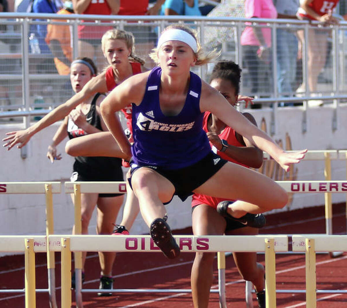 CM's Bella Dugger clears a hurdle on the lead in the 100-meter hurdles at the EA-WR Class 2A Sectional girls track meet on Friday at Memorial Stadium in Wood River. Dugger won in a school-record time to advance to state.
