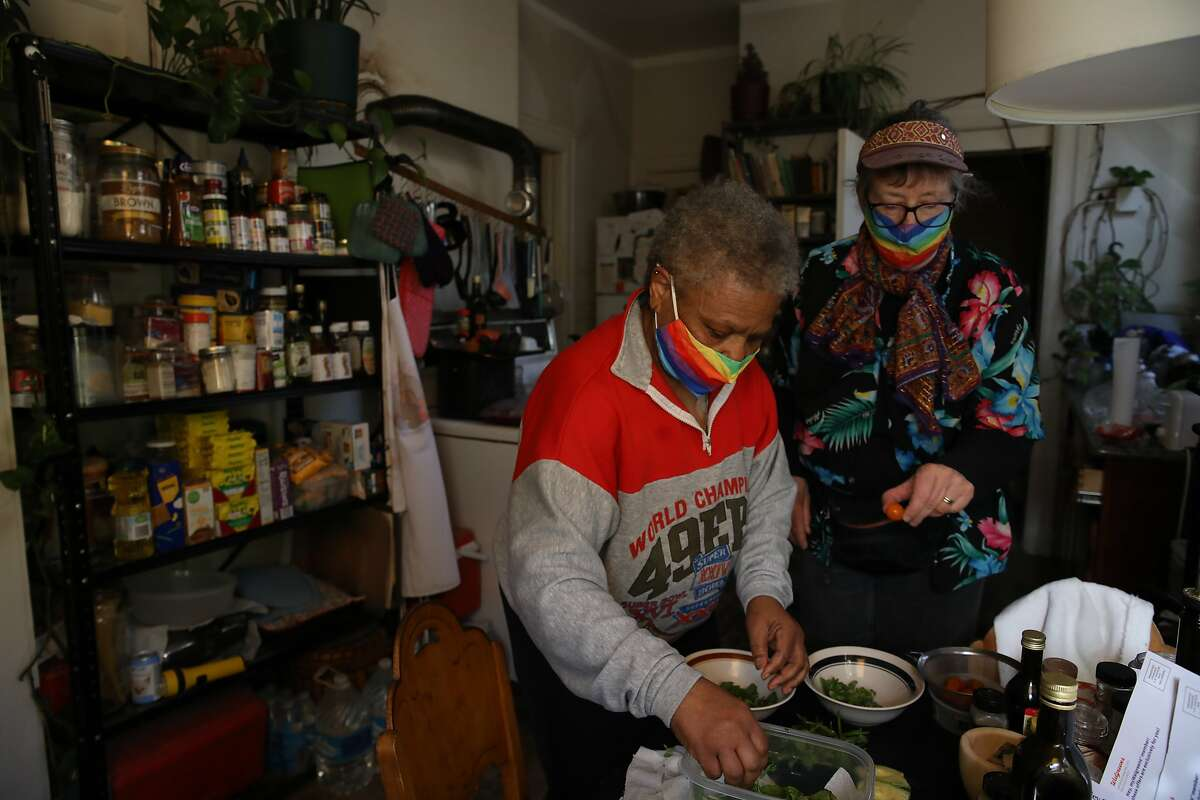 Gale Golden (left) and her wife, Jeanine Reisbig, make dinner in their Castro kitchen.