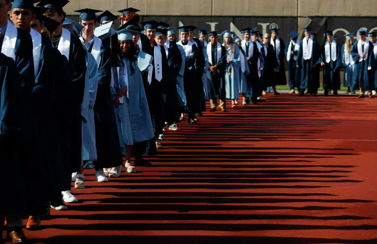 Kingwood High School students file into Turner Stadium for a graduation, Thursday, June 3, 2021, in Humble.