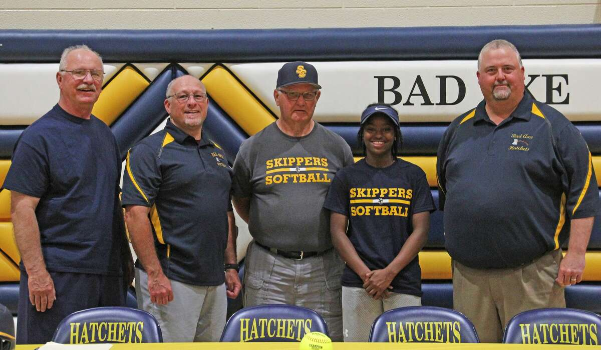 Bad Axe senior Lexi Booms signed a letter of intent Friday to play softball for the St. Clair County Community College Skippers.