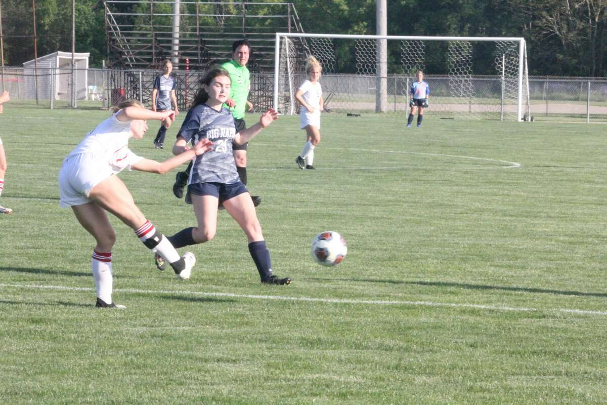 Big Rapids' girls soccer team blanks Whitehall on Friday to win the district championship.