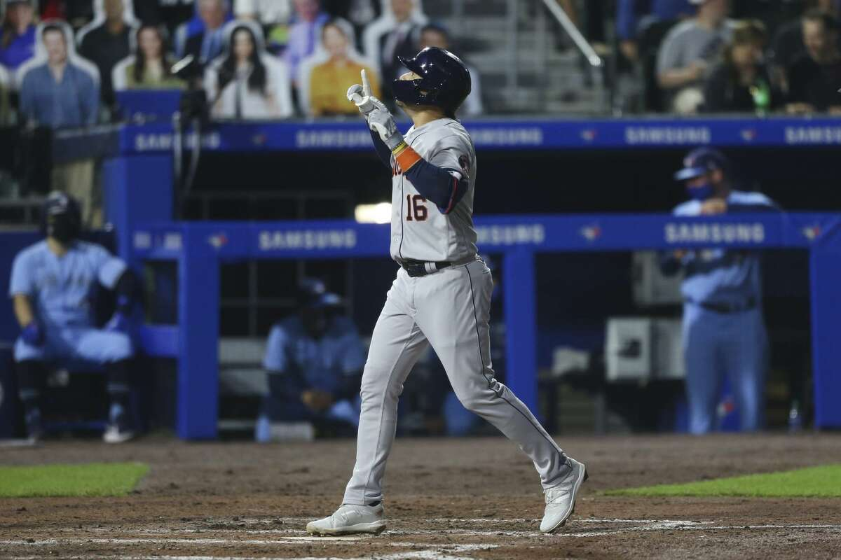 Houston Astros' Aledmys Diaz scores on a home run during the seventh inning of the team's baseball game against the Toronto Blue Jays in Buffalo, N.Y., Friday, June 4, 2021. (AP Photo/Joshua Bessex)