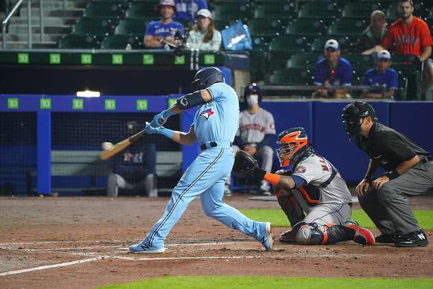 BUFFALO, NY - JUNE 4: Randal Grichuk #15 of the Toronto Blue Jays hits a home run during the seventh inning against the Houston Astros at Sahlen Field on June 4, 2021 in Buffalo, New York. (Photo by Kevin Hoffman/Getty Images) Photo: Kevin Hoffman/Getty Images / 2021 Getty Images
