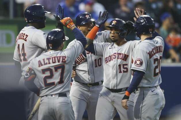 Houston Astros' Martin Maldonado (15) celebrates with Yuli Gurriel (10), Chas McCormick (20), Yordan Alvarez (44), and Jose Altuve (27) after hitting a grand slam during the sixth inning of the team's baseball game against the Toronto Blue Jays in Buffalo, N.Y., Friday, June 4, 2021. (AP Photo/Joshua Bessex) Photo: Joshua Bessex/Associated Press / Copyright 2021 The Associated Press. All rights reserved