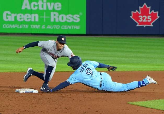 BUFFALO, NY - JUNE 4: Danny Jansen #9 of the Toronto Blue Jays is tagged out by Carlos Correa #1 of the Houston Astros trying to make it to second base on a hit during the sixth inning at Sahlen Field on June 4, 2021 in Buffalo, New York. (Photo by Kevin Hoffman/Getty Images) Photo: Kevin Hoffman/Getty Images / 2021 Getty Images