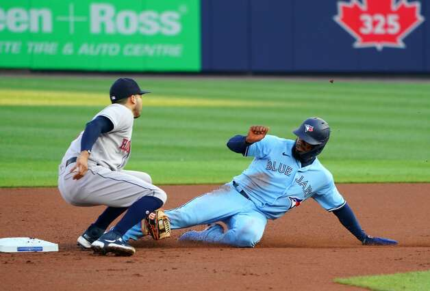 BUFFALO, NY - JUNE 4: Teoscar Hernandez #37 of the Toronto Blue Jays is tagged out by Jose Altuve #27 of the Houston Astros as he tries to steal second base at Sahlen Field on June 4, 2021 in Buffalo, New York. (Photo by Kevin Hoffman/Getty Images) Photo: Kevin Hoffman/Getty Images / 2021 Getty Images