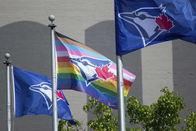 Flags, including a Pride flag, wave outside Sahlen Field before a baseball game between the Toronto Blue Jays and Houston Astros in Buffalo, N.Y., Friday, June 4, 2021. (AP Photo/Joshua Bessex) Photo: Joshua Bessex/Associated Press / Copyright 2021 The Associated Press. All rights reserved