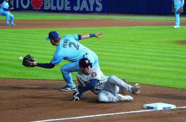 BUFFALO, NY - JUNE 4: Myles Straw #3 of the Houston Astros beats a throw to Joe Panik #2 of the Toronto Blue Jays at third base on a hit by Martin Maldonado #15 of the Houston Astros during the eighth inning at Sahlen Field on June 4, 2021 in Buffalo, New York. (Photo by Kevin Hoffman/Getty Images) Photo: Kevin Hoffman/Getty Images / 2021 Getty Images