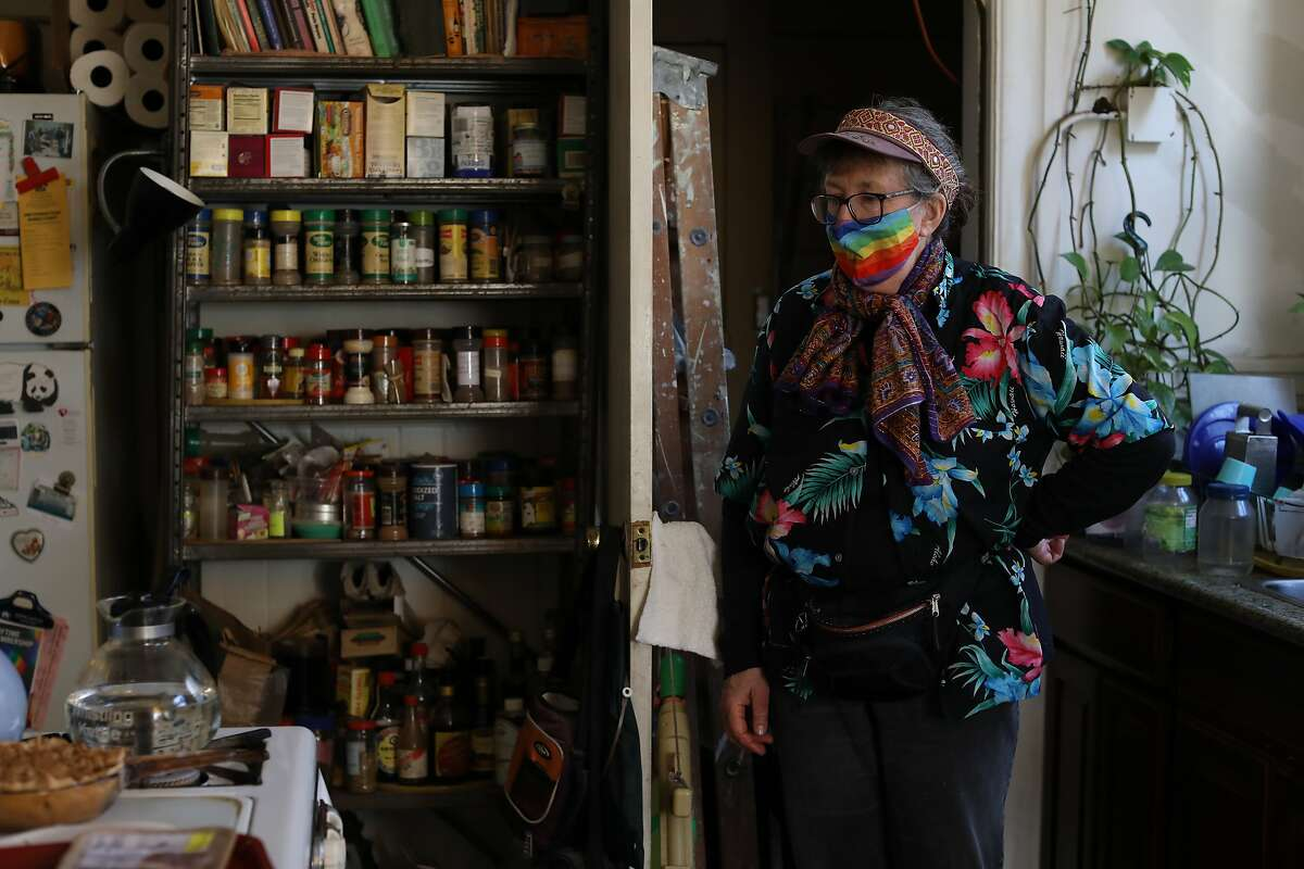 Jeanine Reisbig makes dinner in her kitchen. She and her wife are getting evicted from the Castro apartment they called home for more than 40 years.