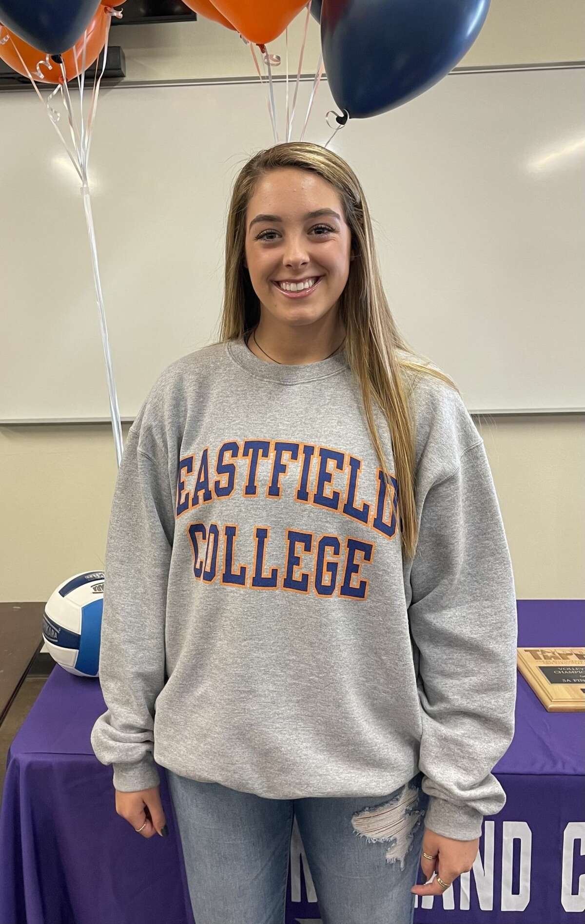 Midland Classical setter Grace Cocohas signed to play volleyball at Dallas College-Eastfield.