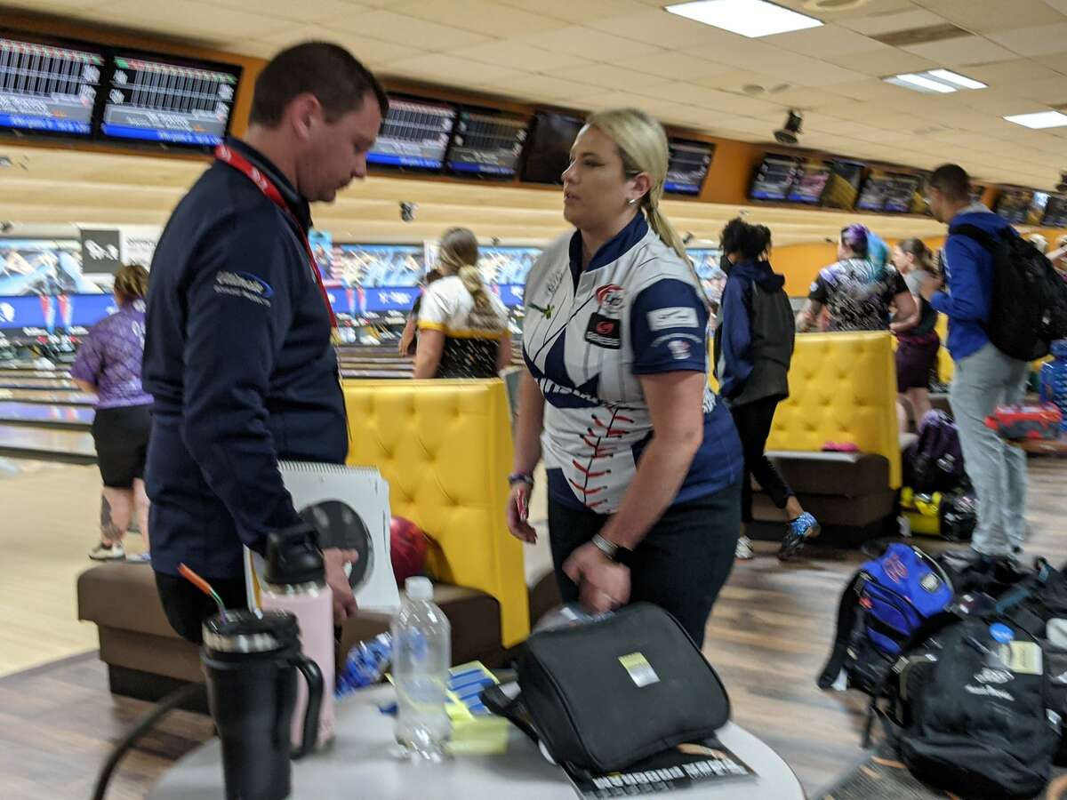 Liz Kuhlkin of Rotterdam talks to one of her Brunswick ball reps, Eric Krauss, during qualifying Friday, June 5, 2021, at the PWBA Albany Open at Kingpin's Alley in South Glens Falls. Kuhlkin finished the day 24th heading into Saturday's play. (Pete Dougherty/Times Union)