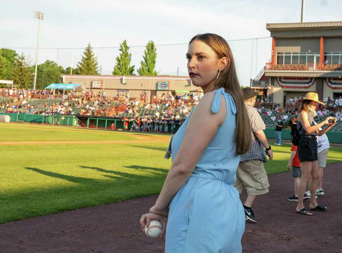 Lizze Buchanan, a COVID survivor, gets ready to throw out a first pitch of the Tri -City ValleyCats home opener against the New Jersey Jakals at the Joseph L. Bruno Stadium on the Hudson Valley Community College campus on Friday, June 4, 2021 (Jim Franco/Special to the Times Union)