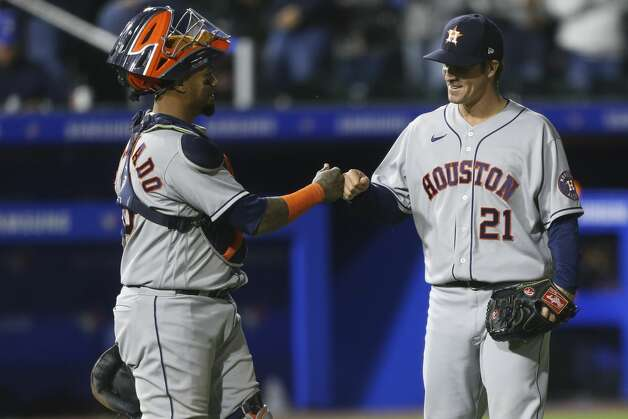 Houston Astros catcher Martin Maldonado (15) and starting pitcher Zack Greinke (21) celebrate after the last out of a baseball game against the Toronto Blue Jays in Buffalo, N.Y., Friday, June 4, 2021. (AP Photo/Joshua Bessex) Photo: Joshua Bessex/Associated Press / Copyright 2021 The Associated Press. All rights reserved