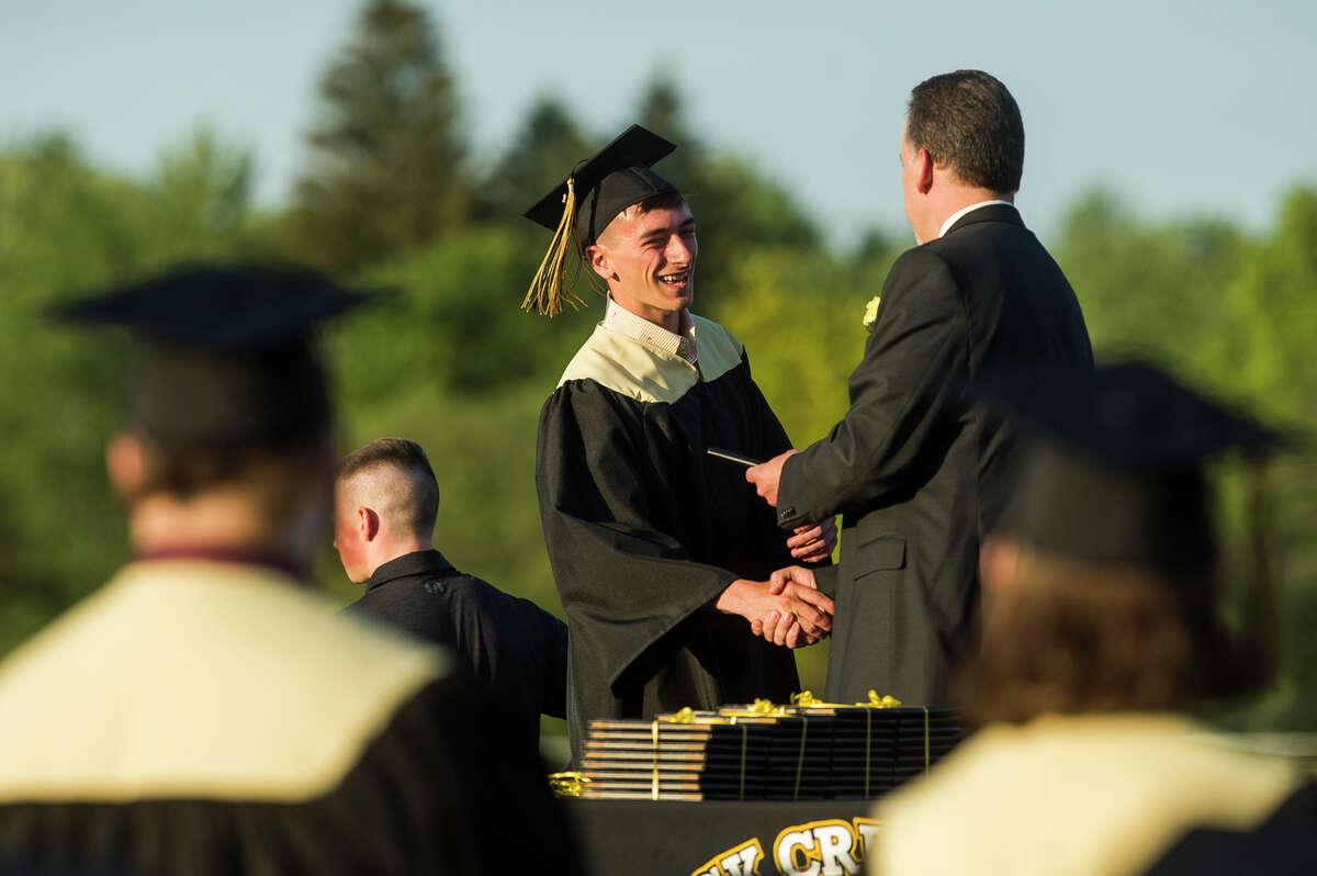 Cameron Nasrey receives his diploma as the Bullock Creek High School Class of 2021 celebrates with a commencement ceremony Friday, June 4, 2021 at the school in Midland. (Katy Kildee/kkildee@mdn.net)