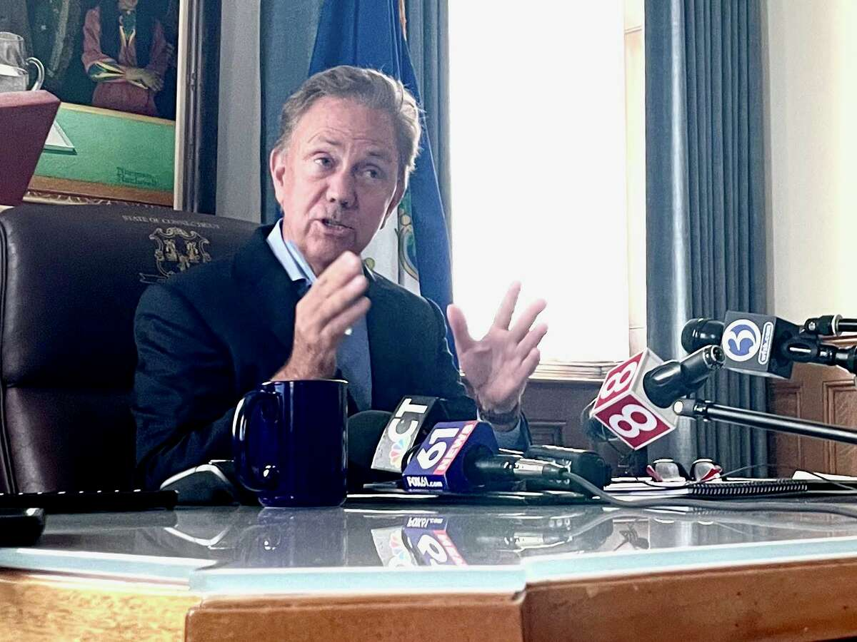 Gov. Ned Lamont, in his office, describes a tentative deal on a 2-year state budget for 2021-23, on Friday, June 4, 2021.