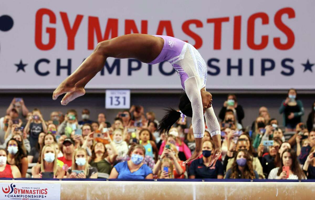 Simone Biles' score of 14.35 on the balance beam was the best of any gymnast Friday at the USA Gymnastics Championships in Fort Worth. Her total score of 59.75 bested Sunisa Lee by 2.4 points.